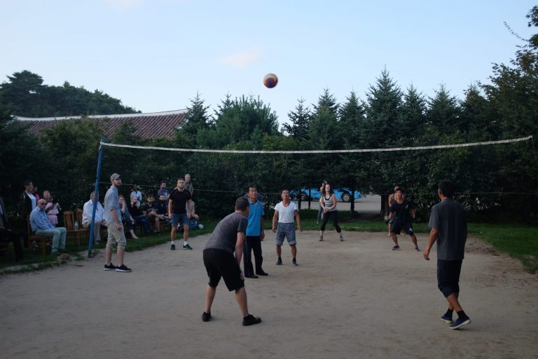Tourists play volleyball with north Koreans on a tour