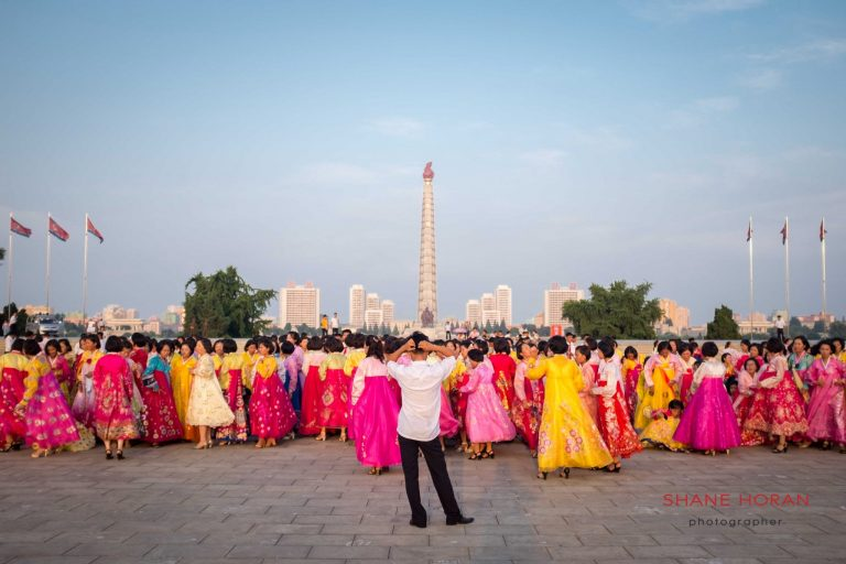 Post mass dance in Kim Il Sung Square. The Juche Tower can be seen in Pyongyang, North Korea
