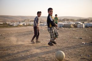 Kids outside a refugee camp in Iraqi Kurdistan on one of our tours to the region