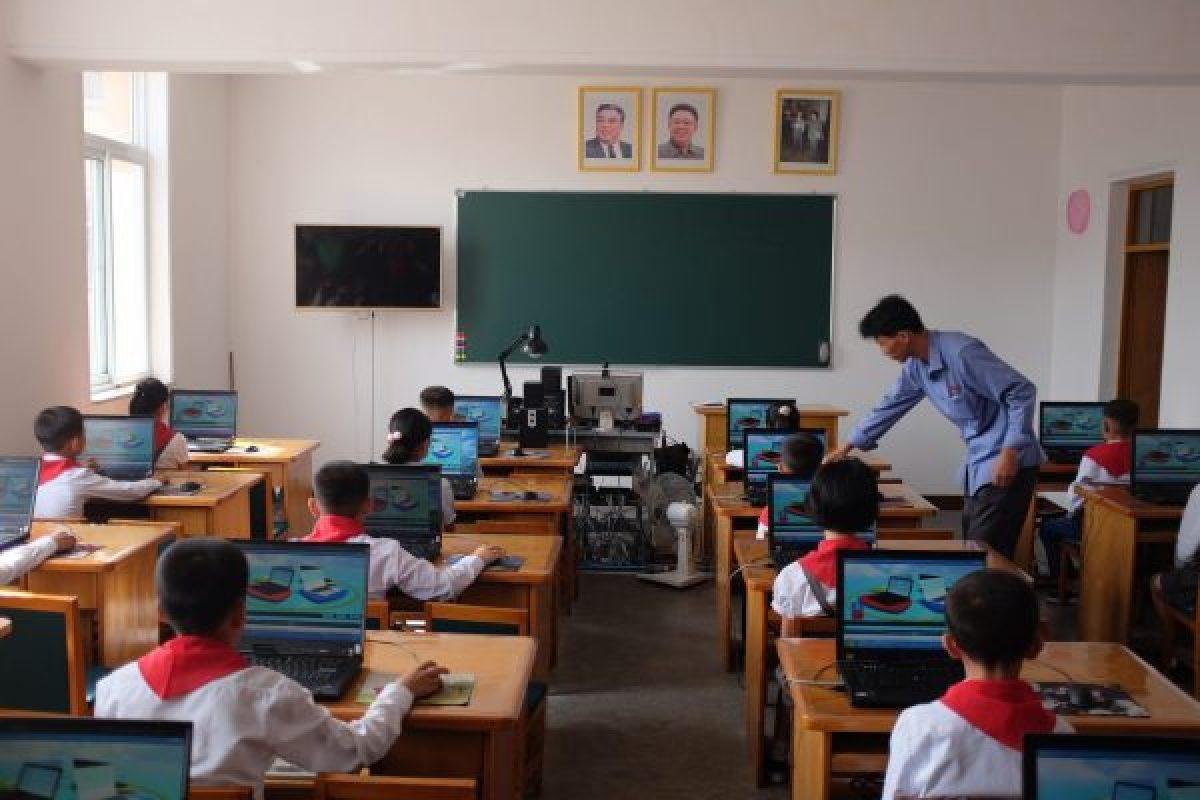 touring a school in North Korea