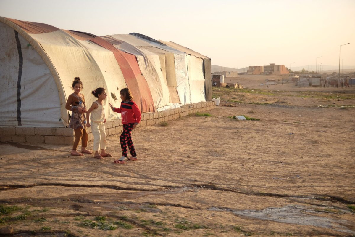 Yazidi children play at a refugee camp in Iraqi Kurdistan